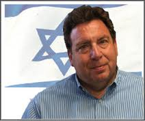 Dr. Rich Freeman in front of Star of David flag